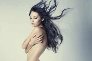 Fashion photo of beautiful nude woman with magnificent hair