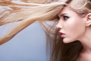 Young attractive girl with flying hair