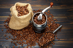 roasted coffee beans on dark wooden background