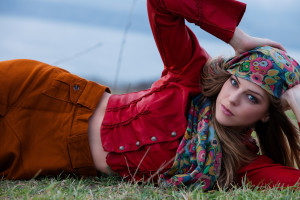 young blonde woman in autumn fashion clothes,  red leather jacket, cashmere scarf and brown skirt outdoor shot