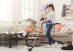 Young woman tired of spring cleaning house, washing floor with vacuum cleaner in messy room, copy space