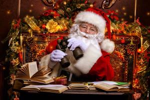 Santa Claus is preparing for Christmas, he looks through binoculars. House of Santa Claus. Christmas decoration.