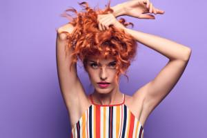 Fashion Portrait Sensual Redhead Woman on Purple