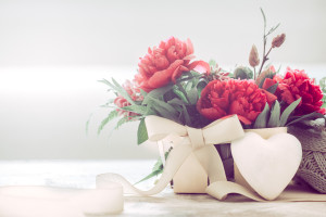 decor of an interior beautiful composition with peonies on a wooden table, concept of style and design