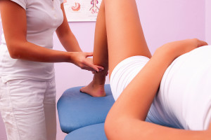 lymphatic drainage massage to female patient in studio