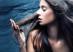 sensual woman portrait, long hair in motion, profile, studio shot